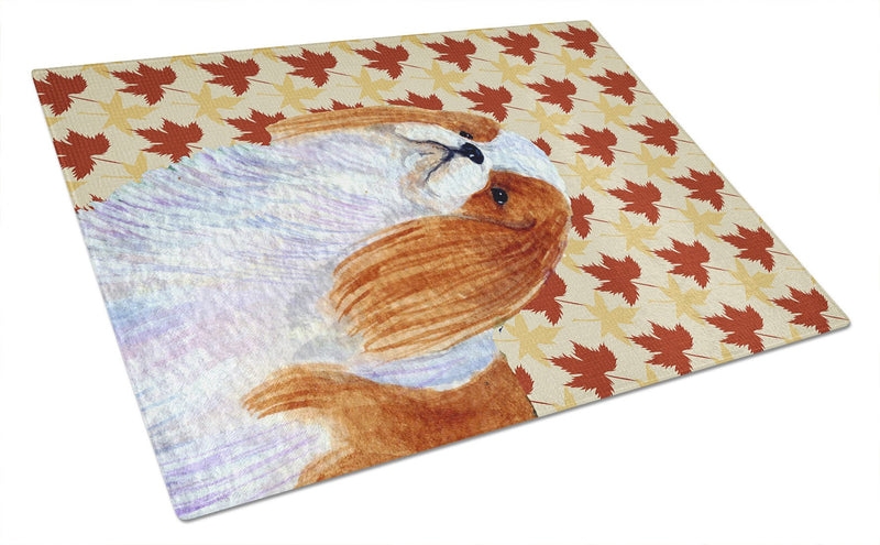 Buy this English Toy Spaniel Fall Leaves Portrait Glass Cutting Board Large