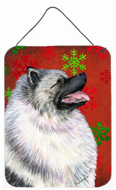 Keeshond Red and Green Snowflakes Holiday Christmas Wall or Door Hanging Prints by Caroline's Treasures