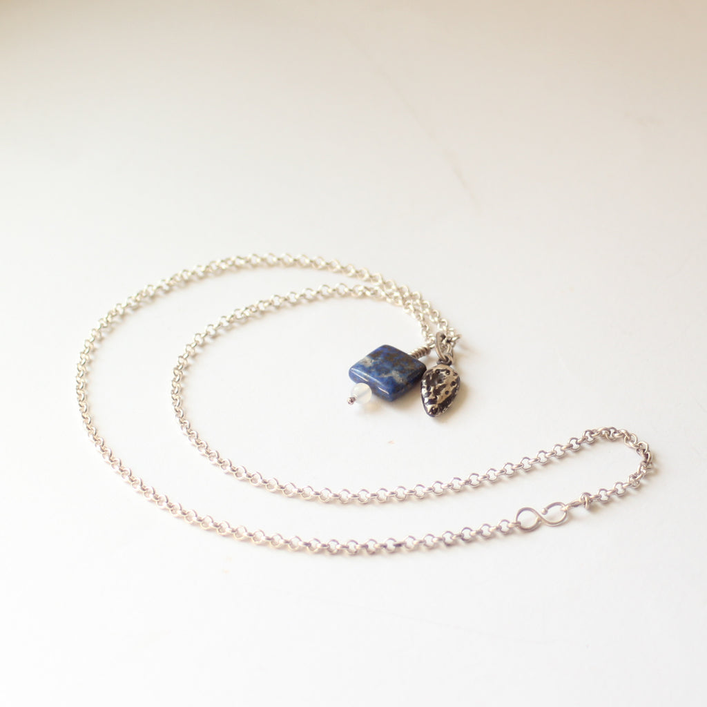 Bead and sterling silver charm necklace