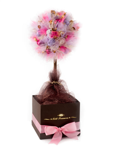 U can see chocolate edible tree in brown box with pink ribbon. The tree features 45 Godiva truffles and pink, purple and white tulle.