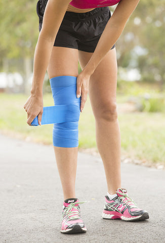 woman putting coolxchange compression wrap on