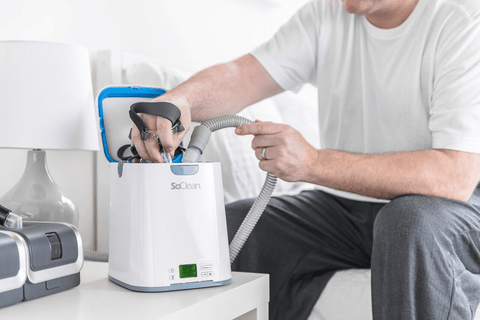 SoClean 2 CPAP Cleaner and Sanitizer open with man taking mask out