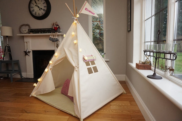 teepee tent with window and name flag