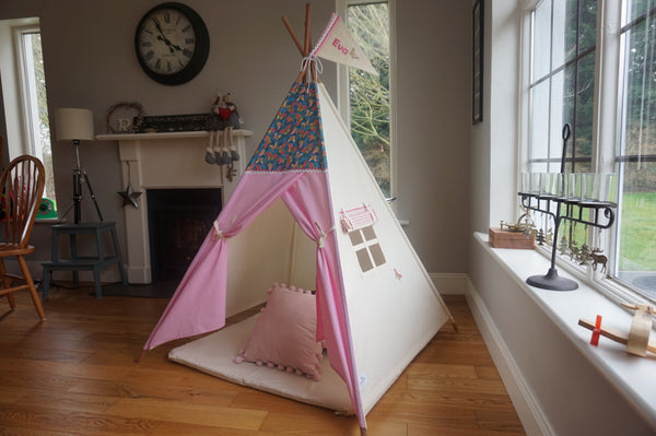 Kids teepee with butterfly design.