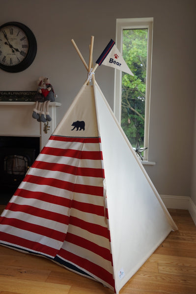 Teepee with red striped doors and navy bear