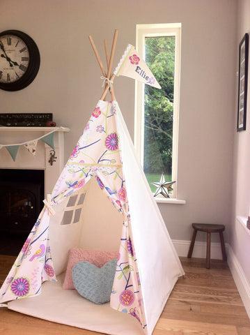 childs teepee with floral fabric