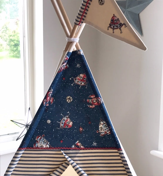 play tent for child with rocket ship fabric