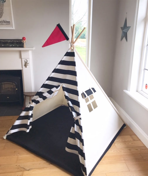 teepee tent for kids with black and white stripe front. photo showing tent with pink flag