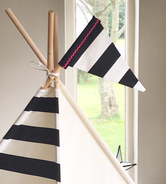 teepee tent for kids with black and white stripe front. photo showing tent with stripe flag