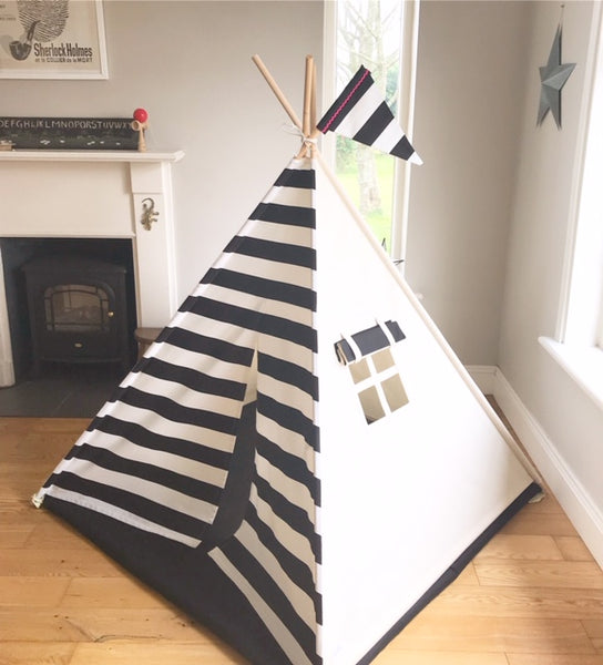 teepee tent for kids with black and white stripe front. Teepee also has a side window with a black shade.