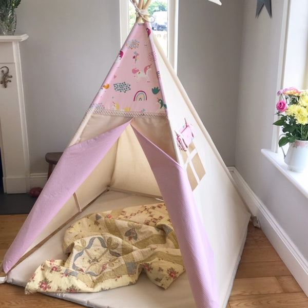 Teepee with unicorn fabric stripe doors and a padded mat