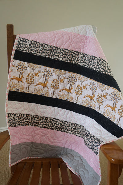 pink and black patchwork quilt