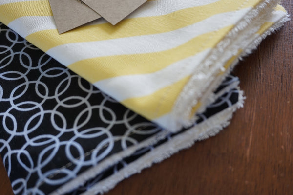 black and yellow burp cloth