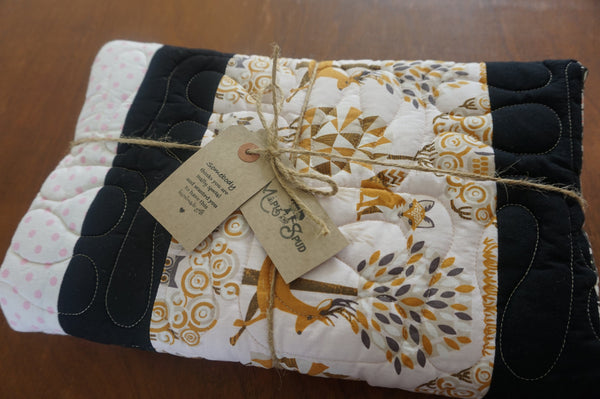 girls patchwork quilt parcelled up