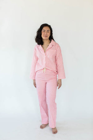 Pink Gingham Flannel Pajama Set - Made from 100% super soft Cotton flannel, they feature a button front shirt with convenient front pockets, matching pants with an adjustable drawstring waistline, super soft handfeel, and vibrant pink print