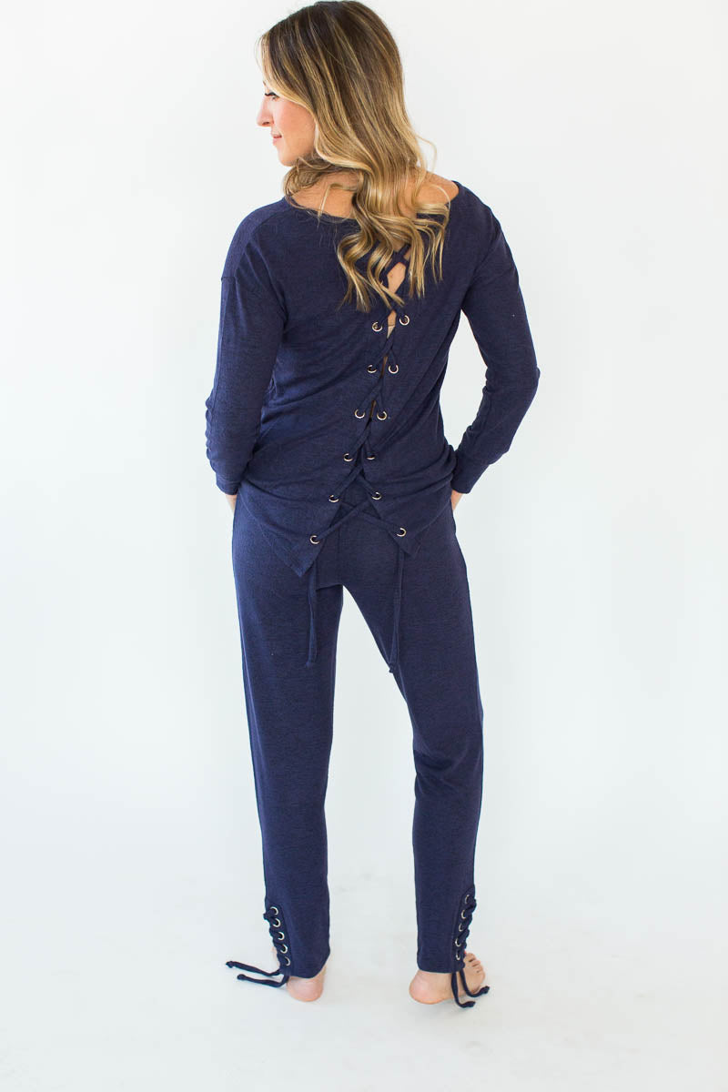 Back View of Embroidered Weekend Fleece with a Laced Back Pullover in Eclipse Blue that Features a Long-Sleeved Shirt and Matching Pants with a Laced-Tie Ankle Bottom