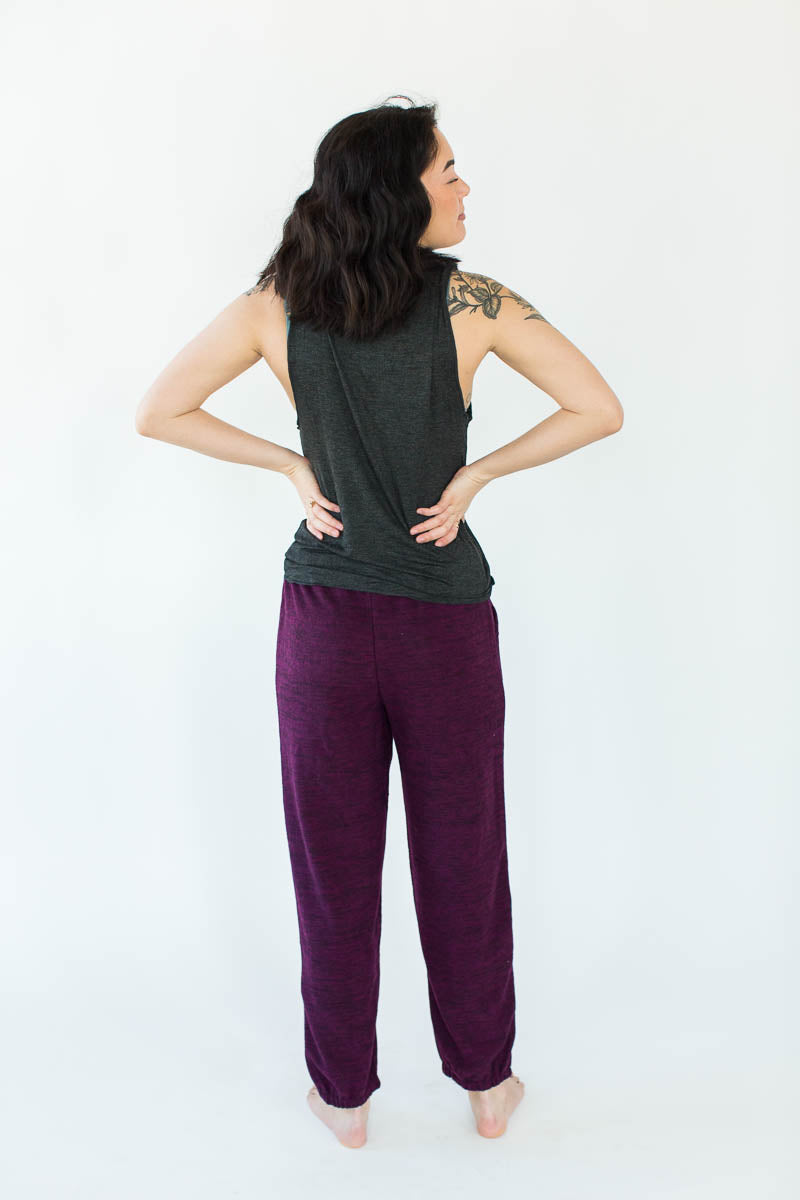 Back View of Outlined LA ZY Lounge Tank & Weekend Fleece Jogger Set in Heather Black & Plum (Black Top with Square Plum Outline around a White LA ZY Text with Matching Plum Jogger)
