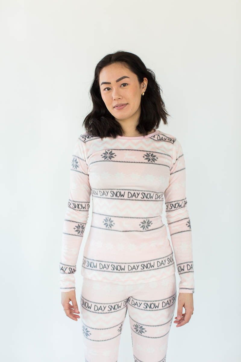 "Snow Day Fair Isle Minky Fleece Tight Fit Set in Light Pink with Alternating Columns of Gray Snowflakes and Gray ""Snow Day"" Text All-Over Print"