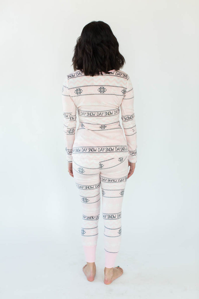 "Back View of Snow Day Fair Isle Minky Fleece Tight Fit Set in Light Pink with Alternating Columns of Gray Snowflakes and Gray ""Snow Day"" Text All-Over Print"