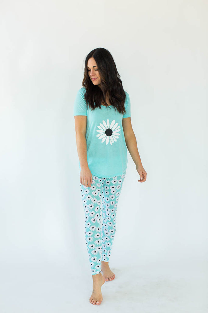 Daisy Printed Tee and Legging Pajama Set in Light Turquoise Blue that Features a Scoop-Lined Tee with One Large, White Daisy Concentrated in the Shirt's Center with Matching Bottoms that Feature an All-Over White Daisy Print