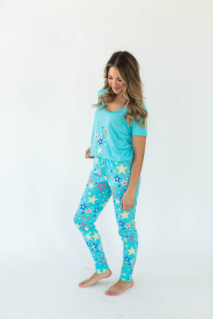 Crazy Star Printed Tee and Legging Pajama Set in Turquoise Blue that Features a Scoop-Lined Tee with Multi-Colored Stars Concentrated in the Shirt's Center with Matching Bottoms that Feature an All-Over Star Print