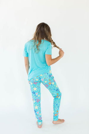 Back View of Crazy Star Printed Tee and Legging Pajama Set in Turquoise Blue that Features a Scoop-Lined Tee with Multi-Colored Stars Concentrated in the Shirt's Center with Matching Bottoms that Feature an All-Over Star Print