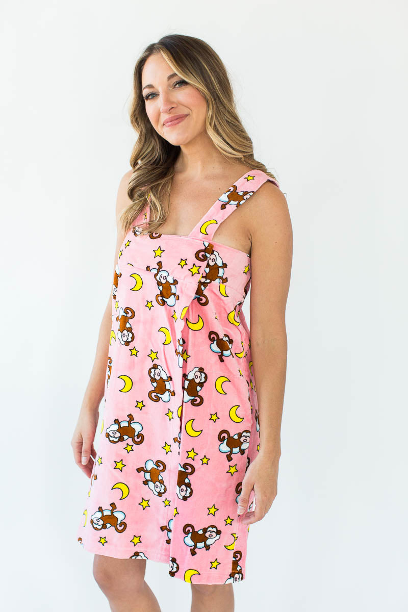 Monkey on Cloud Shower Wrap with Shoulder Straps in Light Pink that Features an All-Over Monkey on a Cloud with Yellow Moon Print