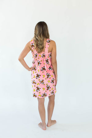 Back View of Monkey on Cloud Shower Wrap with Shoulder Straps in Light Pink that Features an All-Over Monkey on a Cloud with Yellow Moon Print