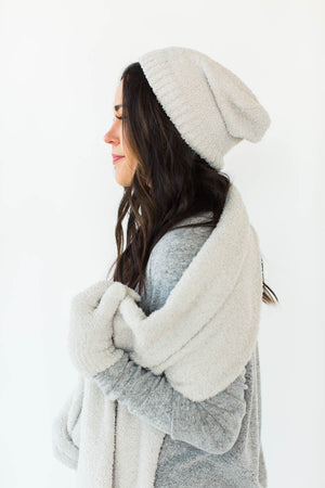 Side View of Winter Sparkle Gift Set in Gray that Features a Matching Sparkly Gray Hat, Scarf, and Gloves