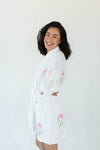 Side View of Rose Applique Short Terry Loop Bathrobe in Bright White with All-Over Colored Rose Appliques that Falls Just Above the Knees & Features an Adjustable Waist Wrap