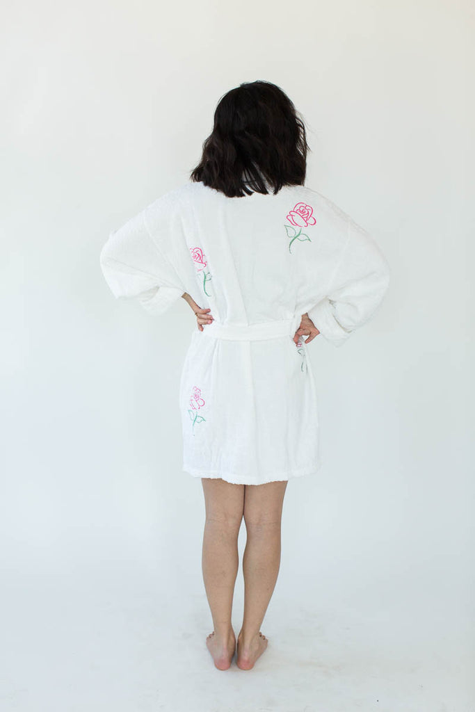 Back View of Rose Applique Short Terry Loop Bathrobe in Bright White with All-Over Colored Rose Appliques that Falls Just Above the Knees & Features an Adjustable Waist Wrap