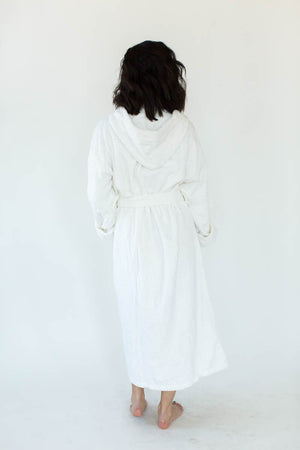 Back View of Unisex Solid Zero Twist Terry Loop Hooded Hotel Spa Bathrobe in White that Falls Just Above the Ankles & Features an Adjustable Waist Wrap