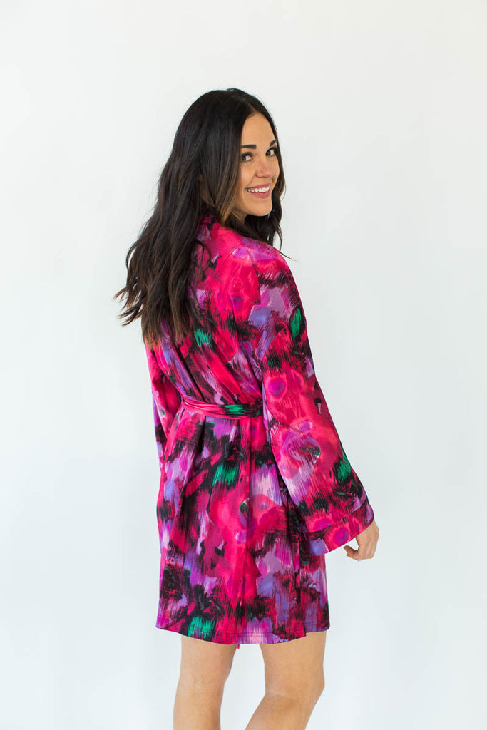 Back View of Abstract Paint Stretch Tricot Short Robe in Various Shades of Pink with All-Over Brush Stroke Inspired Print that Falls Just Above the Knee