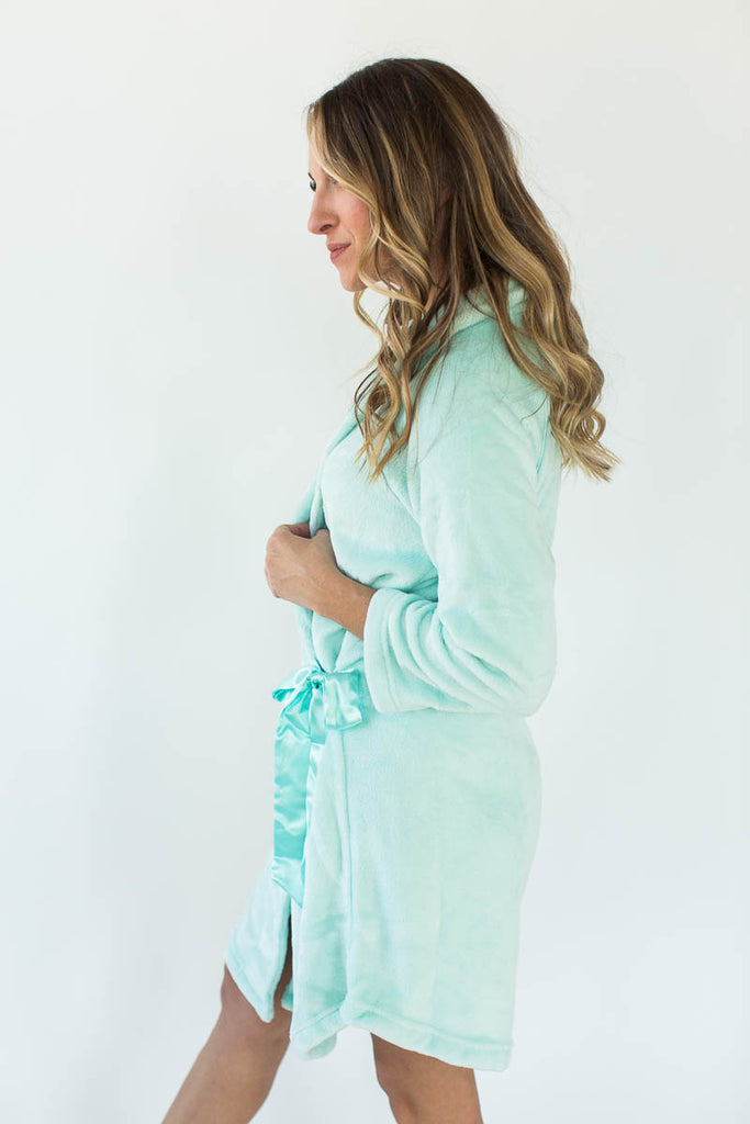 Side View of Cashmere Plush Rounded Hem Side Tie Robe in Solid Mint that Falls Just Above the Knee & Features an Attached Satin Side Waist Tie Belt