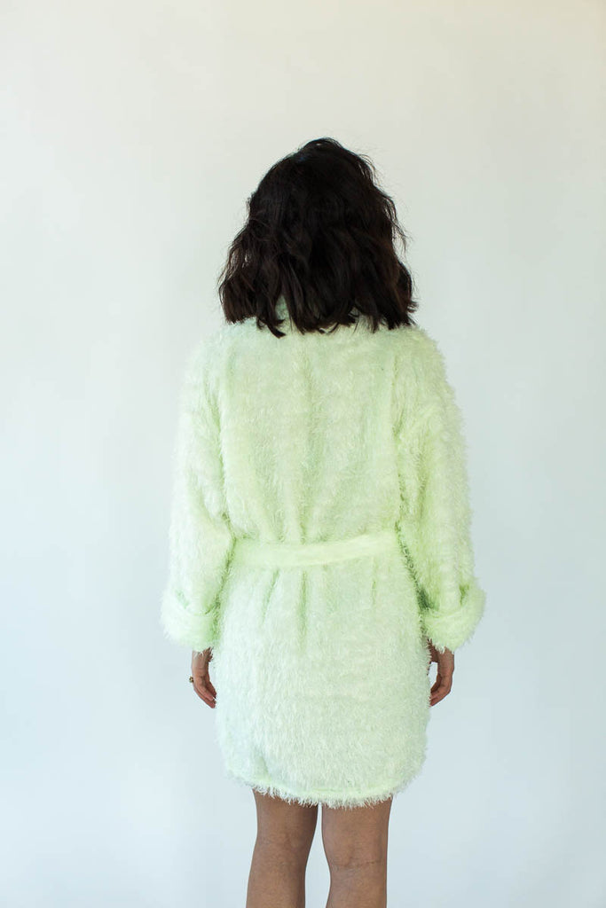 Back View of Furry Robe in Lime that Falls Just Above the Knees and Features an Adjustable Fabric Waist Wrap