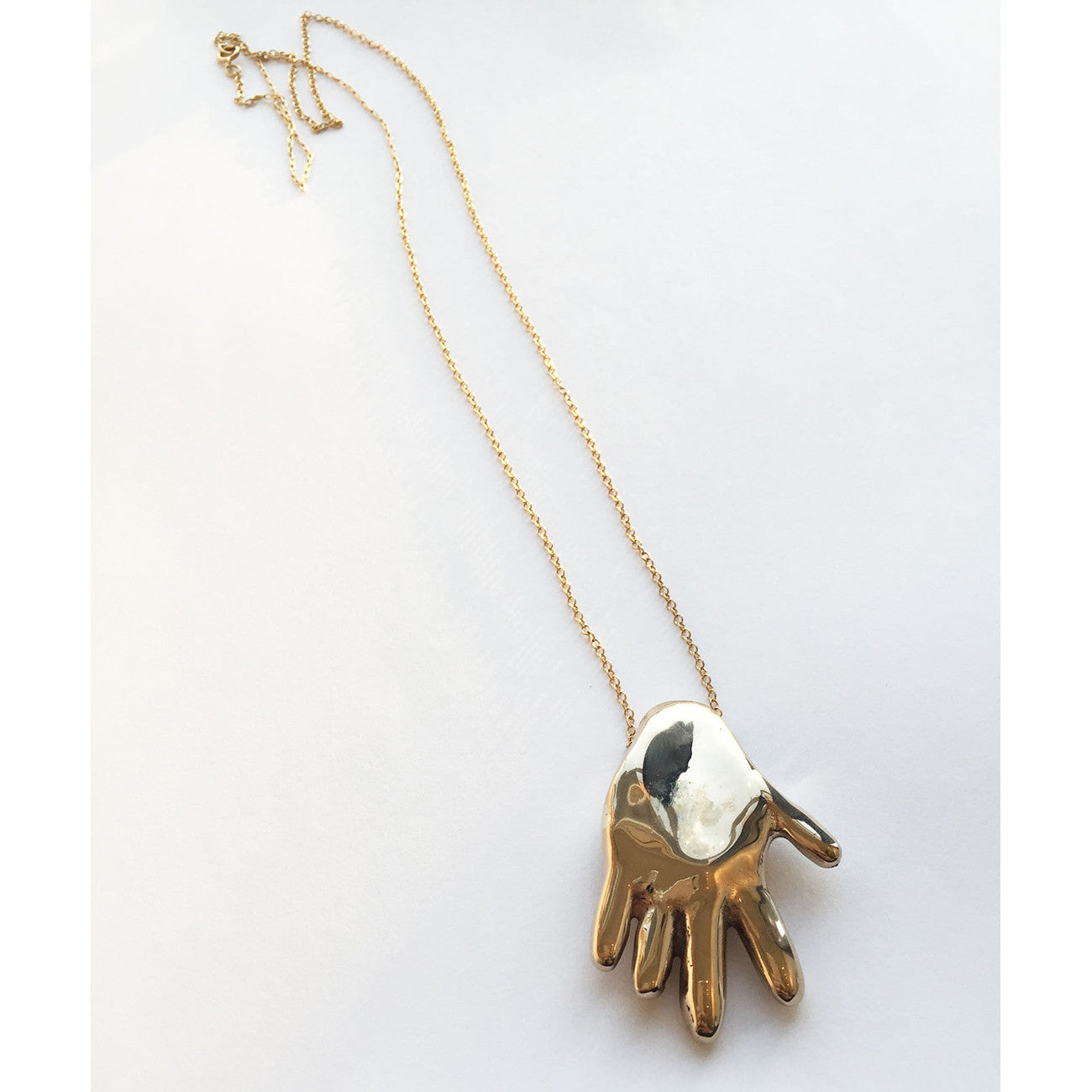 Helen Levi Gilded Hand Necklace on Gold Chain
