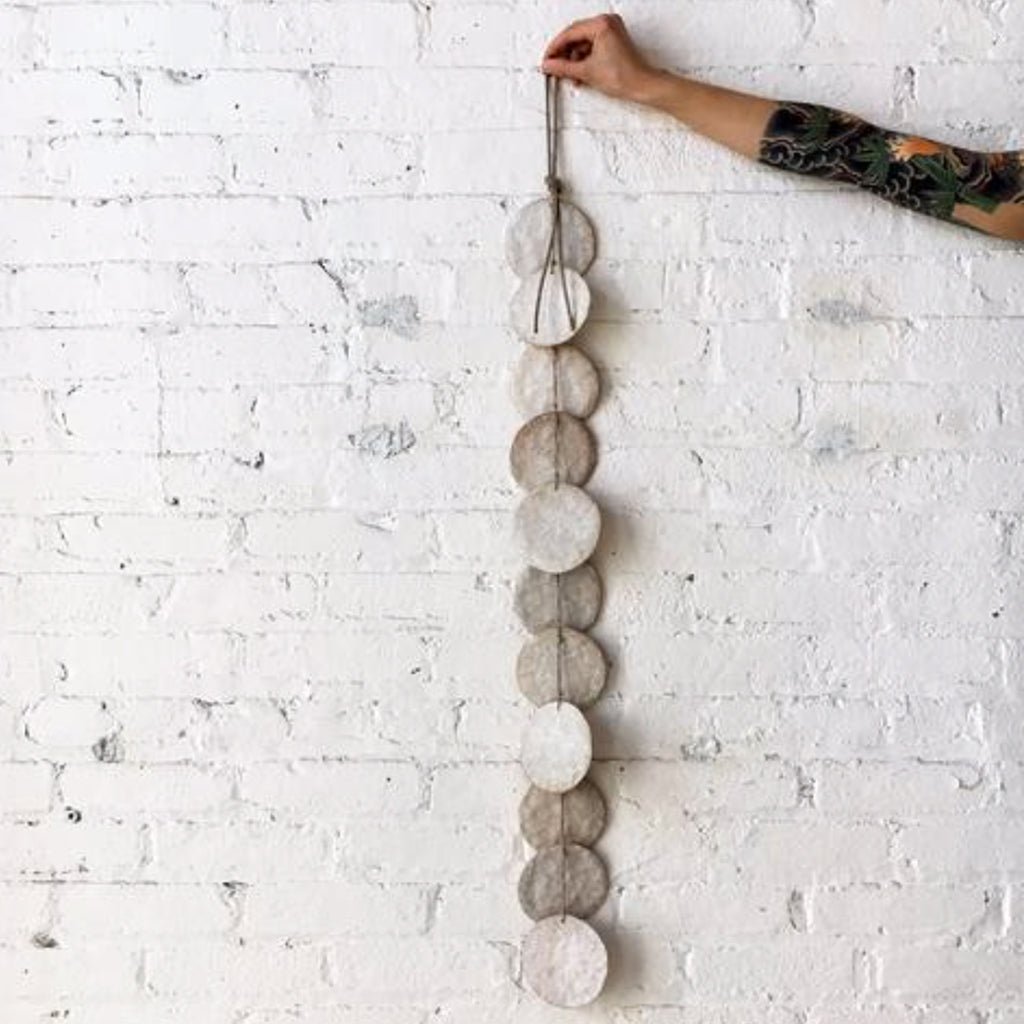white disc wall hanging
