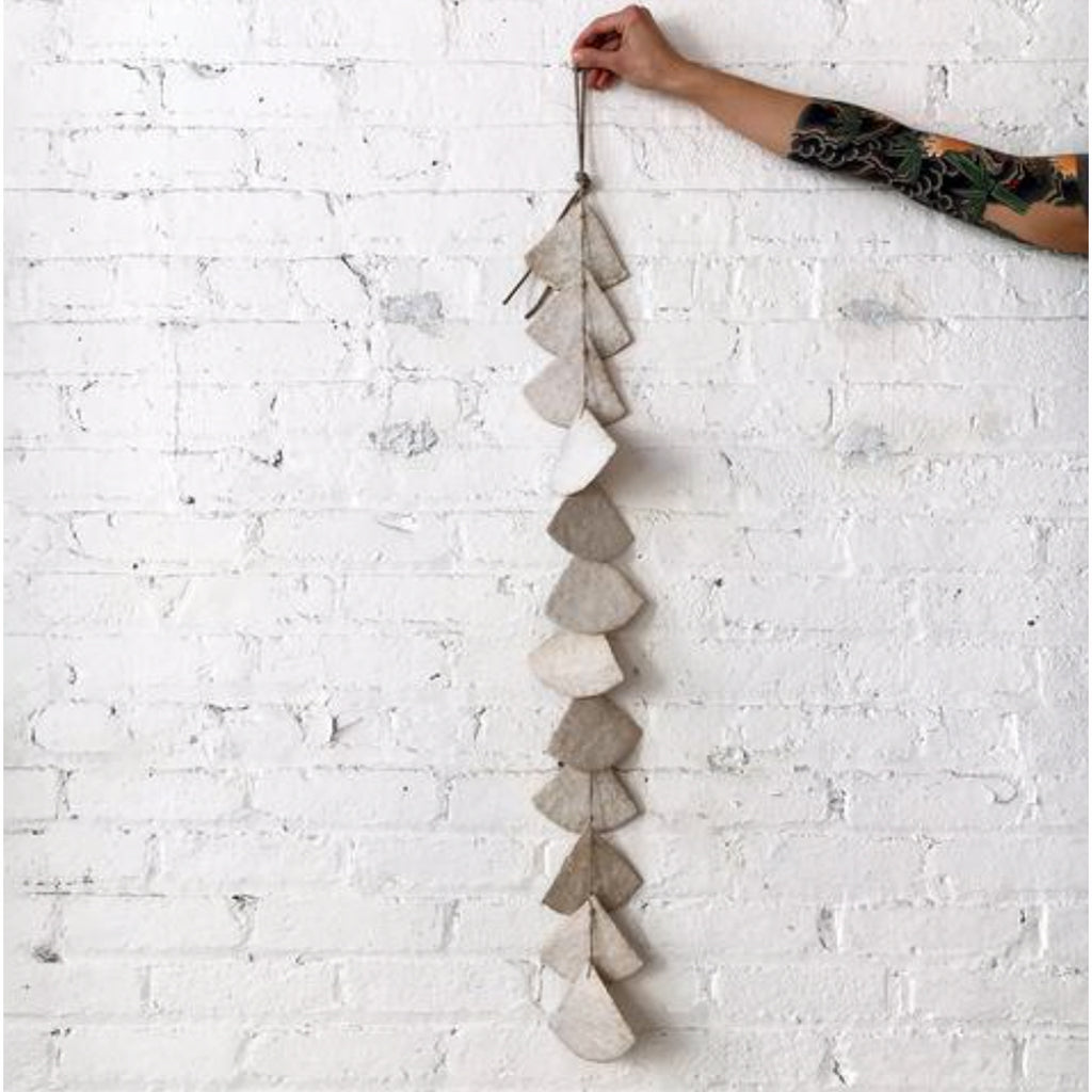 white shell wall hanging