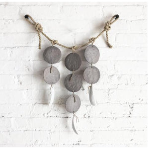 grey discs + featherbones wall hanging