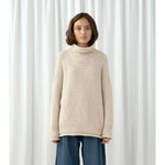 roll neck seed sweater in cream
