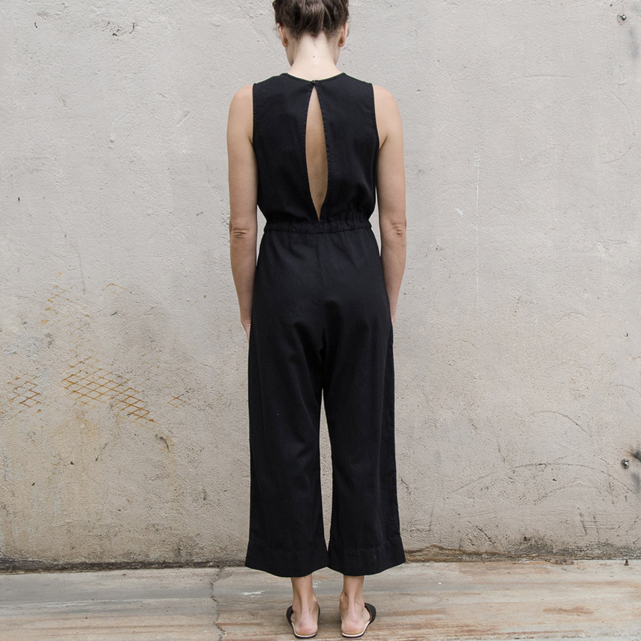 Ali Golden Slit-Back Jumpsuit in Black