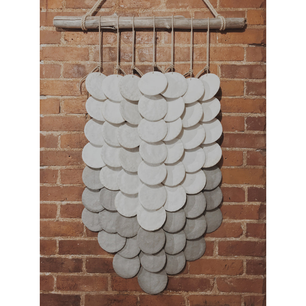 white + grey layered disc wall hanging