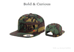 Bold & Curious Camouflage Snap Back Hat