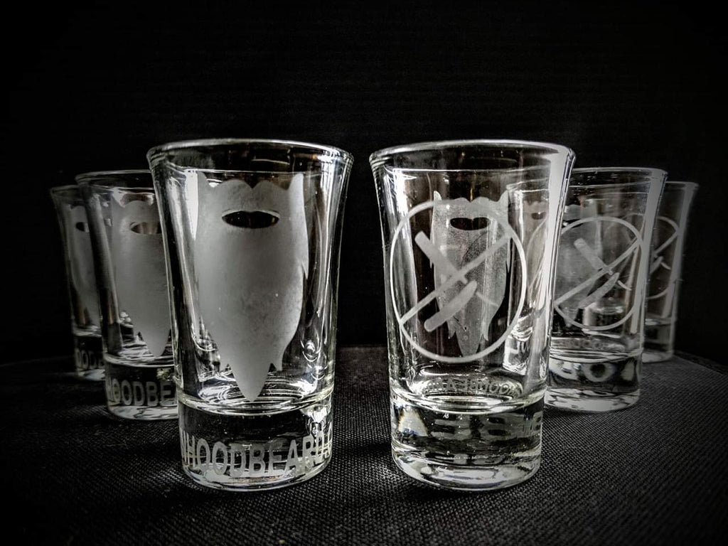 Shot glass Manhood logo