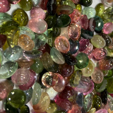 Tourmaline stones in various colours are laying together