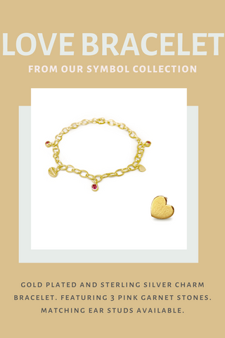Image of gold charm bracelet with pink stones and a heart shaped gold ear stud