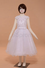 White lace girl's first communion dress with cap sleeves