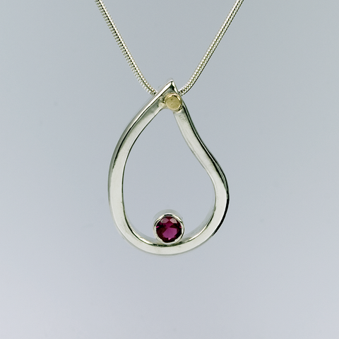 Ruby pendant in sterling silver with touch of gold