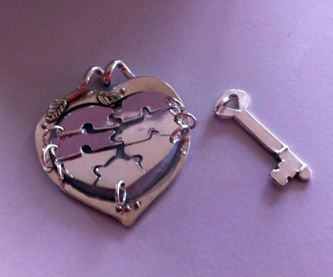 Silver key to heart pendant