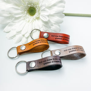 1 Corinthians 13:13. And the greatest of these is love. Handmade leather keychain with snap.